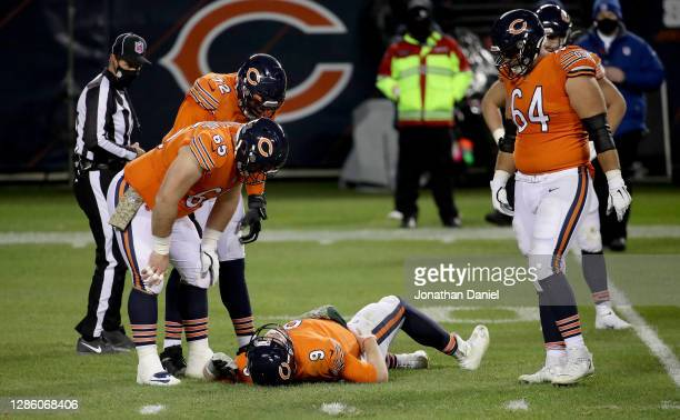 Nick Foles of the Chicago Bears lies on the field after being hit by Ifeadi Odenigbo of the Minnesota Vikings during the fourth quarter of the game...