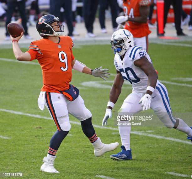 Nick Foles of the Chicago Bears passes under pressure from Justin Houston of the Indianapolis Colts at Soldier Field on October 04, 2020 in Chicago,...