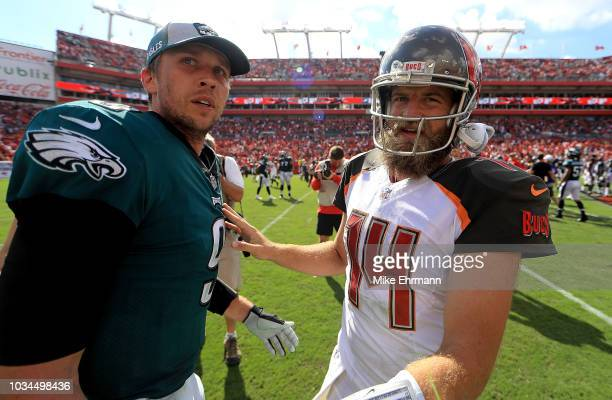 Nick Foles of the Philadelphia Eagles and Ryan Fitzpatrick of the Tampa Bay Buccaneers shake hands following a game at Raymond James Stadium on...