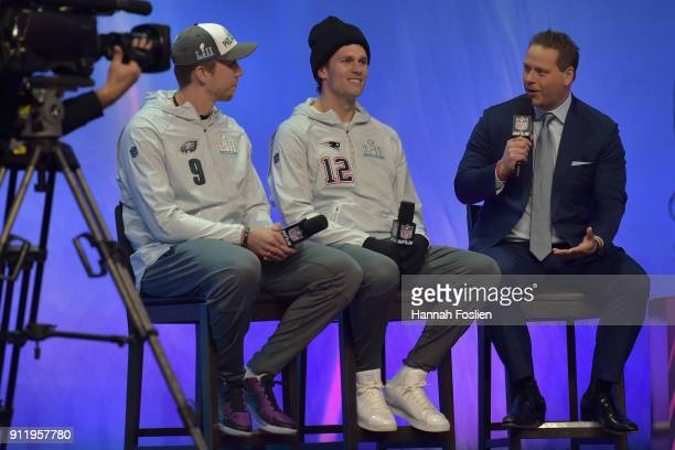 Nick Foles of the Philadelphia Eagles and Tom Brady of the New England Patriots answer questions during Super Bowl Media Day at Xcel Energy Center on...