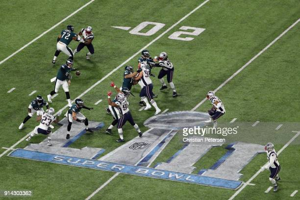 Nick Foles of the Philadelphia Eagles attempts a pass in the first quarter against the New England Patriots in Super Bowl LII at US Bank Stadium on...