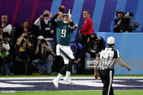 Nick Foles of the Philadelphia Eagles catches a second quarter touchdown reception from teammate Trey Burton against the New England Patriots in...