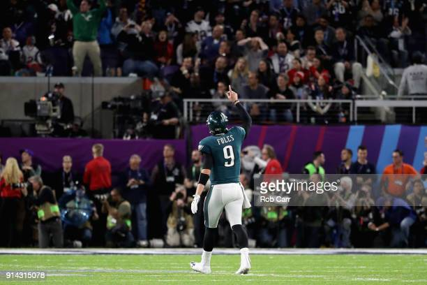 Nick Foles of the Philadelphia Eagles celebrates a second quarter touchdown run by teammate LeGarrette BlLeGarrette Blount against the New England...