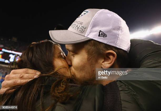 Nick Foles of the Philadelphia Eagles celebrates his teams win over the Minnesota Vikings with his wife Tori Moore in the NFC Championship game at...