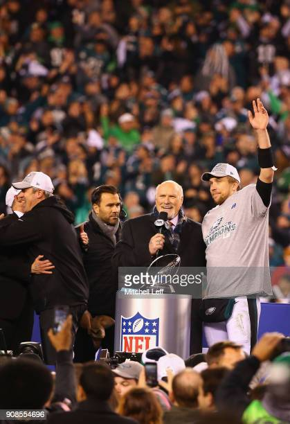 Nick Foles of the Philadelphia Eagles celebrates his teams win over the Minnesota Vikings in the NFC Championship game with Terry Bradshaw at Lincoln...