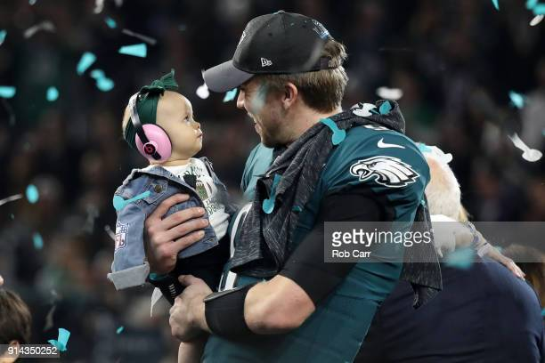 Nick Foles of the Philadelphia Eagles celebrates with his daughter Lily Foles after his 4133 victory over the New England Patriots in Super Bowl LII...