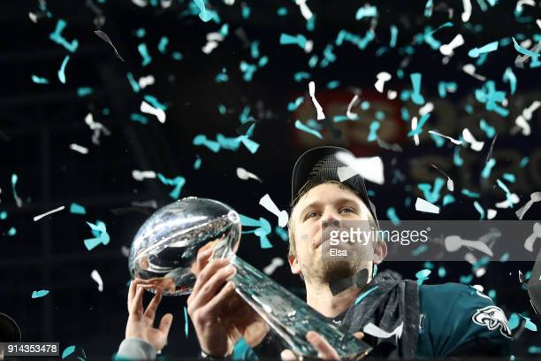 Nick Foles of the Philadelphia Eagles celebrates with the Vince Lombardi Trophy after defeating the New England Patriots 4133 in Super Bowl LII at US...