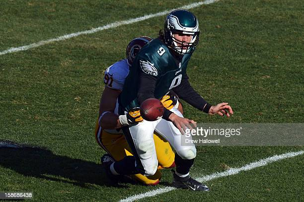 Nick Foles of the Philadelphia Eagles fumbles while being sacked by Ryan Kerrigan of the Washington Redskins at Lincoln Financial Field on December...