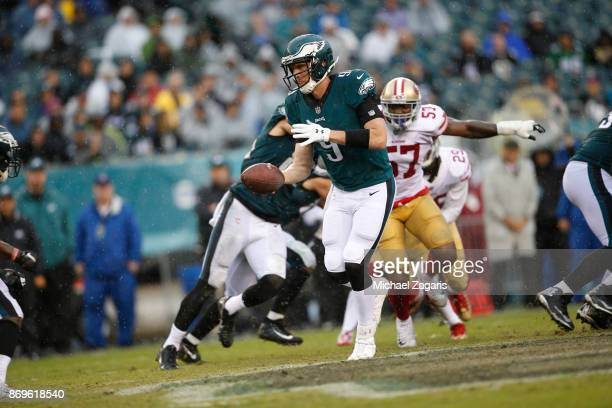 Nick Foles of the Philadelphia Eagles hands the ball off during the game against the San Francisco 49ers at Lincoln Financial Field on October 29...