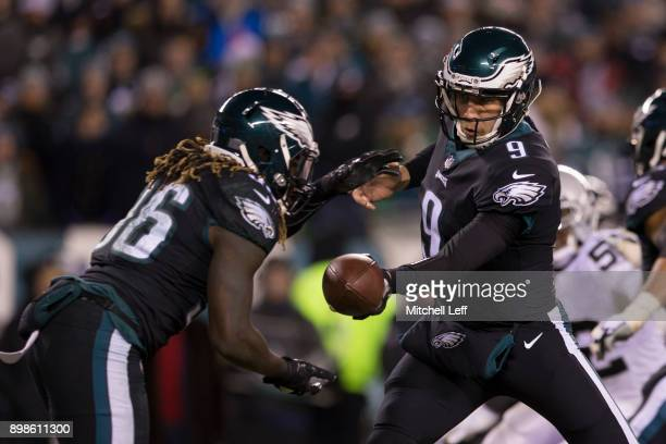 Nick Foles of the Philadelphia Eagles hands the ball off to Jay Ajayi in the first quarter against the Oakland Raiders at Lincoln Financial Field on...