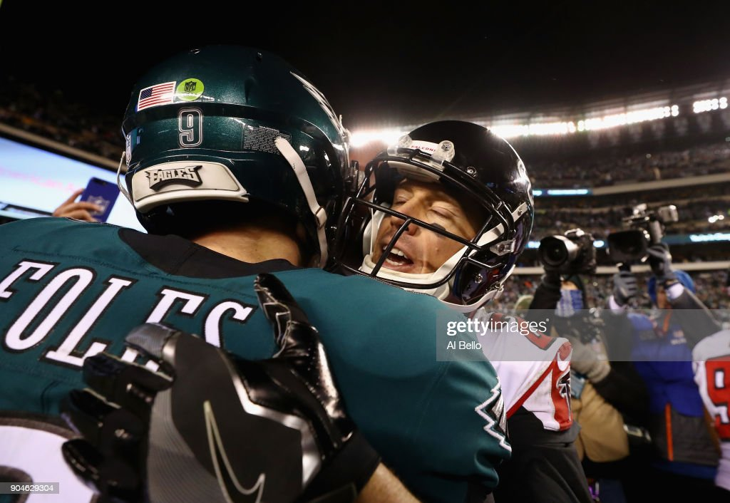 Nick Foles #9 of the Philadelphia Eagles hugs Matt Ryan #2 of the Atlanta Falcons after the NFC Divisional Playoff game at Lincoln Financial Field on January 13, 2018 in Philadelphia, Pennsylvania. The Philadelphia Eagles defeated the Atlanta Falcons with a score of 15 to 10.