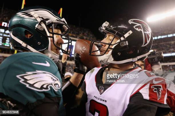 Nick Foles of the Philadelphia Eagles hugs Matt Ryan of the Atlanta Falcons after the NFC Divisional Playoff game at Lincoln Financial Field on...