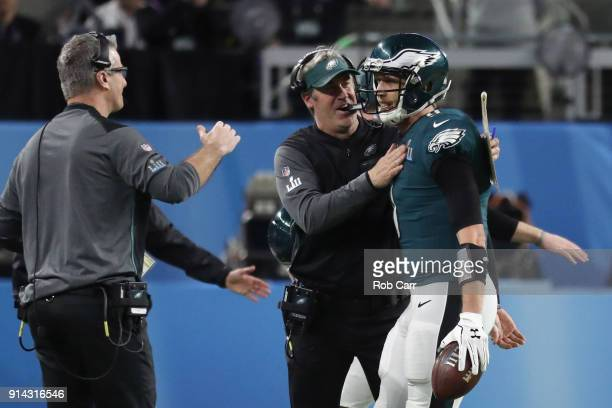 Nick Foles of the Philadelphia Eagles is congratulated by head coach Doug Pederson after his 1yard touchdown reception during the second quarter...