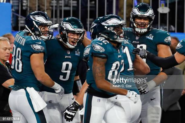 Nick Foles of the Philadelphia Eagles is congratulated by his teammates after his 1yard touchdown reception during the second quarter against the New...