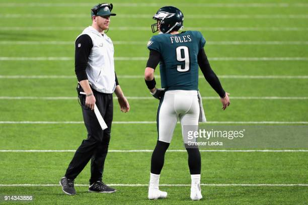 Nick Foles of the Philadelphia Eagles is congratulated by his teammate Carson Wentz after his 11yard touchdown pass during the fourth quarter against...