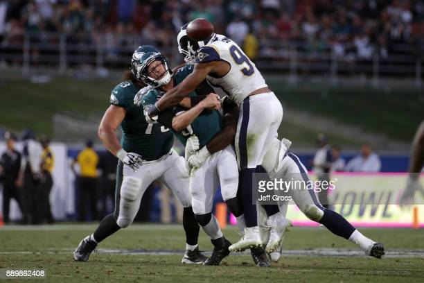 Nick Foles of the Philadelphia Eagles is hit while releasing by Robert Quinn of the Los Angeles Rams during the fourth quarter of the game at the Los...