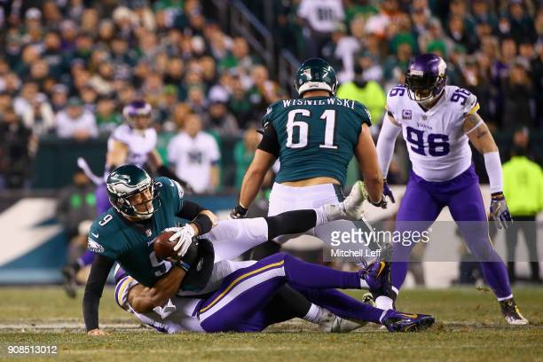 Nick Foles of the Philadelphia Eagles is sacked by Danielle Hunter of the Minnesota Vikings during the second quarter in the NFC Championship game at...