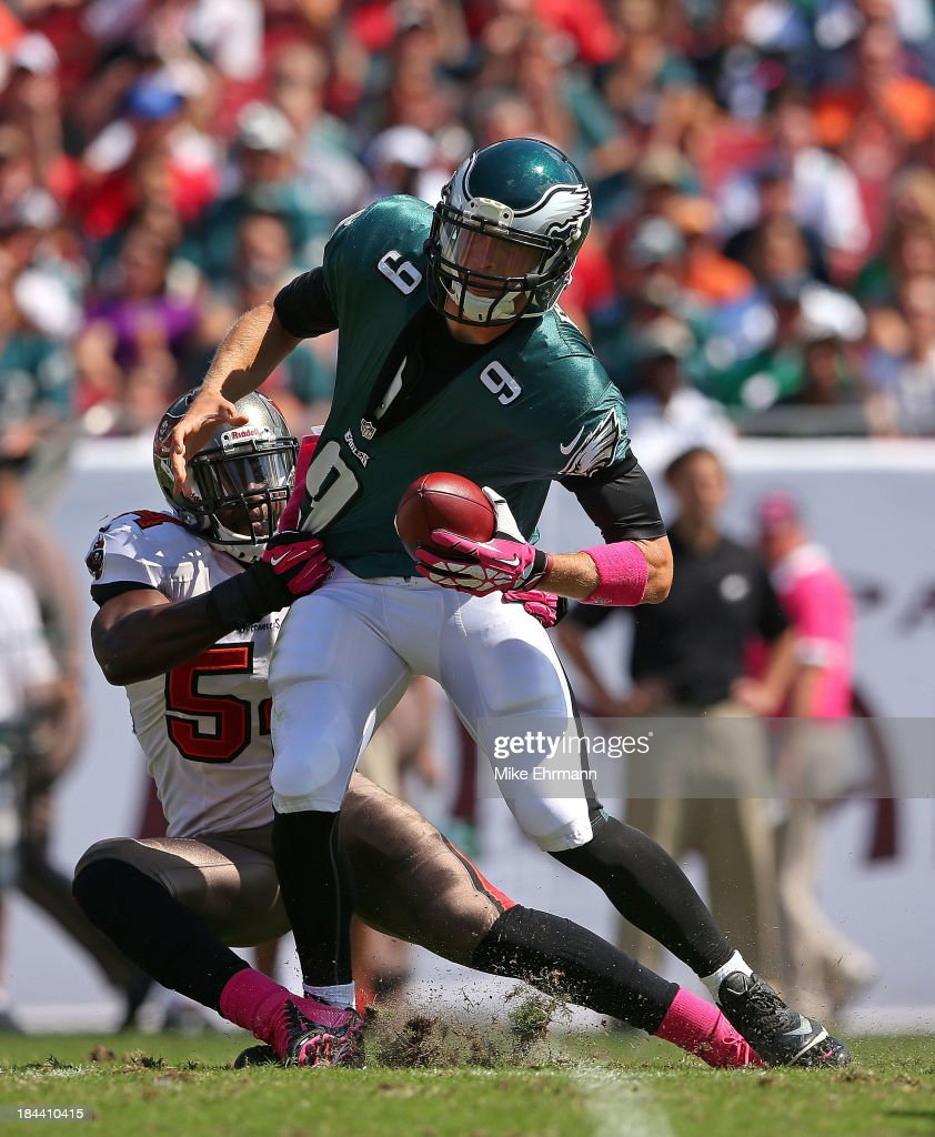 Nick Foles #9 of the Philadelphia Eagles is sacked by Lavonte David #54 of the Tampa Bay Buccaneers during a game at Raymond James Stadium on October 13, 2013 in Tampa, Florida.