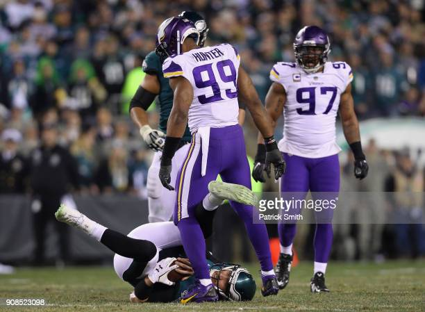 Nick Foles of the Philadelphia Eagles is tackled by Danielle Hunter of the Minnesota Vikings during the second quarter in the NFC Championship game...