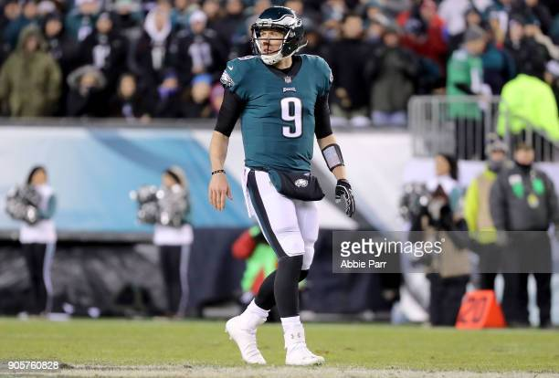 Nick Foles of the Philadelphia Eagles looks on in the second quarter against the Atlanta Falcons during the NFC Divisional Playoff game game at...