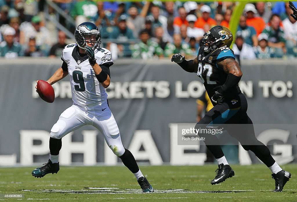 Nick Foles #9 of the Philadelphia Eagles looks to pass as Ziggy Hood #92 of the Jacksonville Jaguars persues during the first half of a NFL game at Lincoln Financial Field on September 7, 2014 in Philadelphia, Pennsylvania.