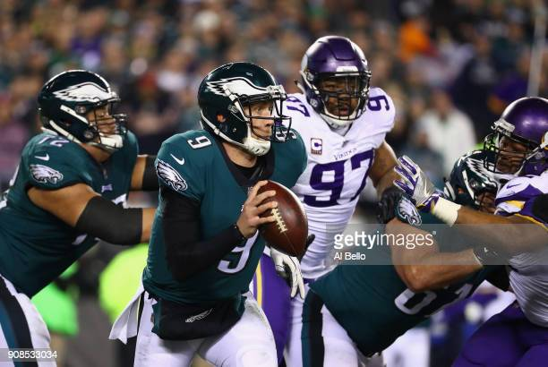 Nick Foles of the Philadelphia Eagles looks to pass during the fourth quarter against the Minnesota Vikings in the NFC Championship game at Lincoln...
