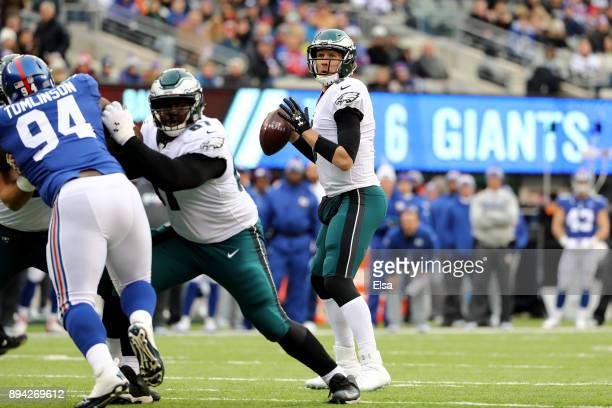 Nick Foles of the Philadelphia Eagles looks to throw a pass against the New York Giants during the first quarter in the game at MetLife Stadium on...