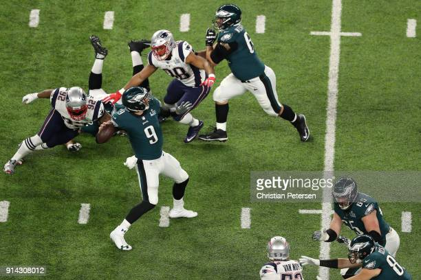 Nick Foles of the Philadelphia Eagles makes a 34yard touchdown pass against the New England Patriots in the first quarter of Super Bowl LII at US...