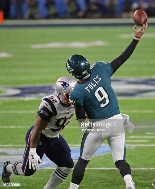 Nick Foles of the Philadelphia Eagles passes as James Harrison of the New England Patriots rushes during Super Bowl Lll at US Bank Stadium on...