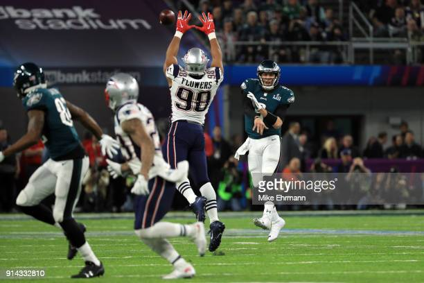 Nick Foles of the Philadelphia Eagles passes the ball against Trey Flowers of the New England Patriots during the third quarter in Super Bowl LII at...