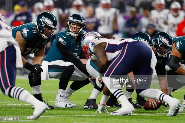 Nick Foles of the Philadelphia Eagles prepares to snap the ball during the fourth quarter against the New England Patriots in Super Bowl LII at US...