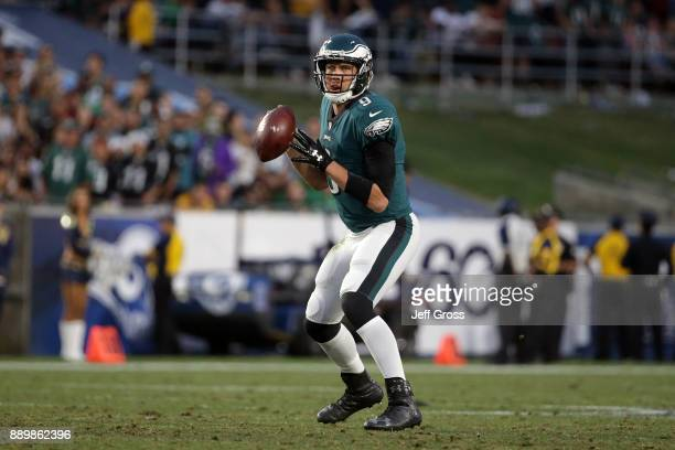 Nick Foles of the Philadelphia Eagles prepares to throw a pass during the game against the Los Angeles Rams at the Los Angeles Memorial Coliseum on...
