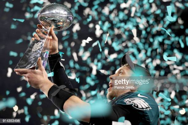 Nick Foles of the Philadelphia Eagles raises the Vince Lombardi Trophy after defeating the New England Patriots 41-33 in Super Bowl LII at U.S. Bank...