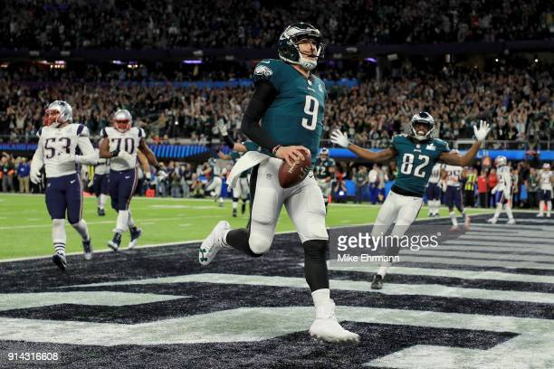 Nick Foles of the Philadelphia Eagles reacts after a 1-yard touchdown reception against the New England Patriots during the second quarter in Super...