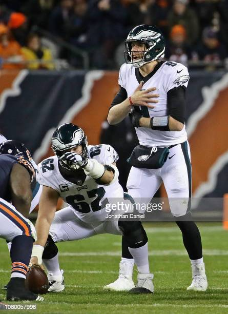 Nick Foles of the Philadelphia Eagles signals to the offense as Jason Kelce waits to snap the ball against the Chicago Bears during an NFC Wild Card...
