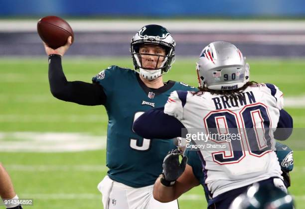 Nick Foles of the Philadelphia Eagles throws an 11 yard touchdown pass against Malcom Brown of the New England Patriots during the fourth quarter in...