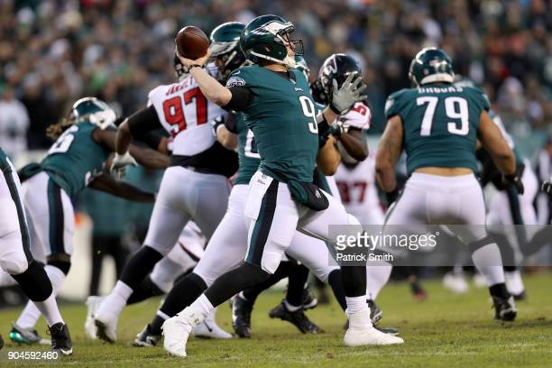 Nick Foles of the Philadelphia Eagles throws the ball against the Atlanta Falcons during the first quarter in the NFC Divisional Playoff game at...