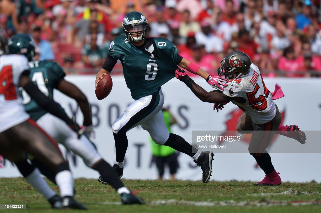 Nick Foles #9 of the Philadelphia Eagles tries to get away from Lavonte David #54 of the Tampa Bay Buccaneers at Raymond James Stadium on October 13, 2013 in Tampa, Florida. The Eagles won 30-21.