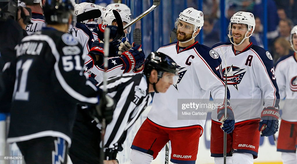 Nick Foligno #71 and Boone Jenner #38 of the Columbus Blue Jackets celebrate a goal against the Tampa Bay Lightning at the Amalie Arena on January 13, 2017 in Tampa, Florida.
