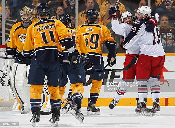 Nick Foligno and Ryan Johansen of the Columbus Blue Jackets celebrate a goal against Pekka Rinne of the Nashville Predators during season opener at...