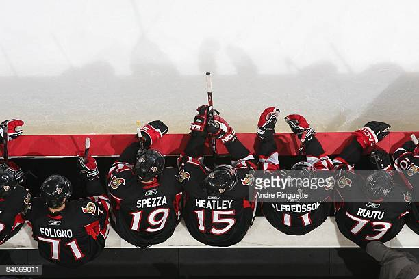 Nick Foligno Dany Heatley Daniel Alfredsson Jason Spezza and Jarkko Ruutu of the Ottawa Senators sit on the bench during their NHL game against the...
