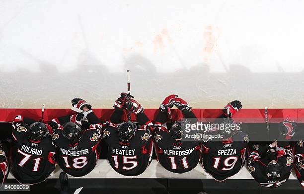 Nick Foligno Jesse Winchester Dany Heatley Daniel Alfredsson and Jason Spezza of the Ottawa Senators sit on the bench during their NHL game against...