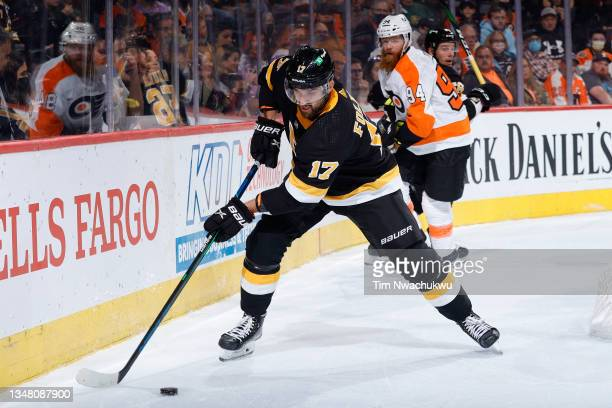 Nick Foligno of the Boston Bruins clears the puck against the Philadelphia Flyers at Wells Fargo Center on October 20, 2021 in Philadelphia,...