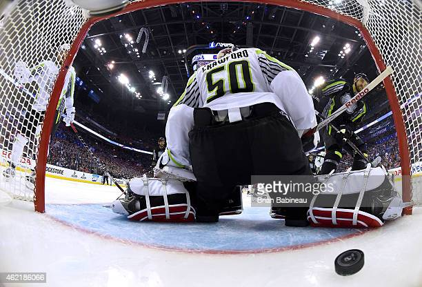 Nick Foligno of the Columbus Blue Jackets and Team Foligno scores against goaltender Corey Crawford of the Chicago Blackhawks and Team Toews in the...