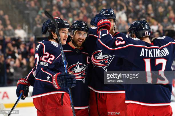 Nick Foligno of the Columbus Blue Jackets celebrates his third period goal with teammates Sonny Milano Seth Jones and Cam Atkinson of the Columbus...