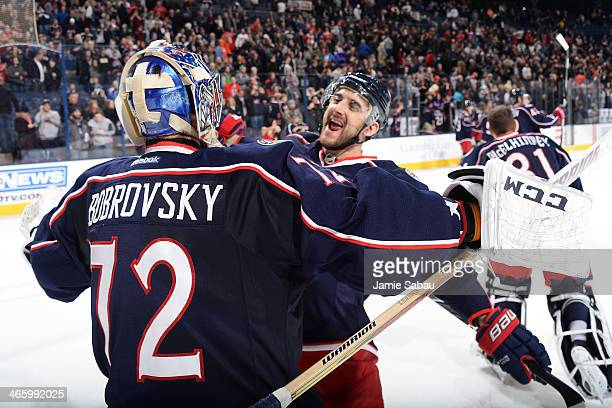 Nick Foligno of the Columbus Blue Jackets celebrates with Sergei Bobrovsky of the Columbus Blue Jackets after defeating the Washington Capitals 5-2...