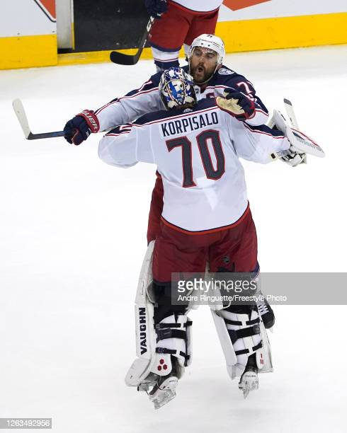 Nick Foligno of the Columbus Blue Jackets congratulates Joonas Korpisalo after he recorded the team's first shut out after defeating the Toronto...