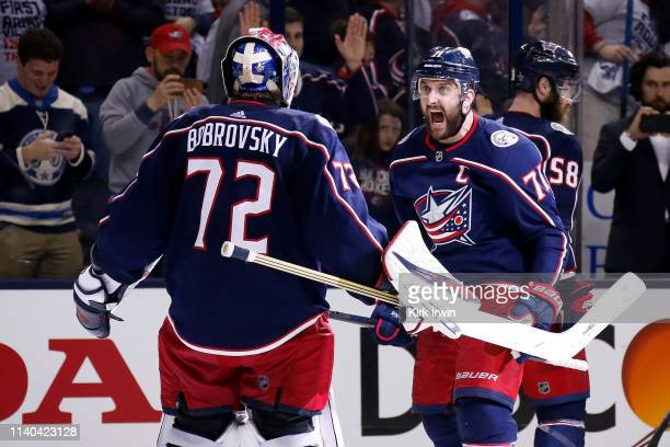 Nick Foligno of the Columbus Blue Jackets congratulates Sergei Bobrovsky after defeating the Boston Bruins 2-1 in Game Three of the Eastern...