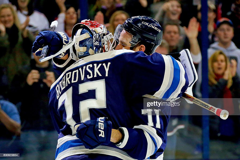 Nick Foligno #71 of the Columbus Blue Jackets congratulates Sergei Bobrovsky #72 after defeating the Edmonton Oilers 3-1 for the teams 16th consecutive victory on January 3, 2017 at Nationwide Arena in Columbus, Ohio.