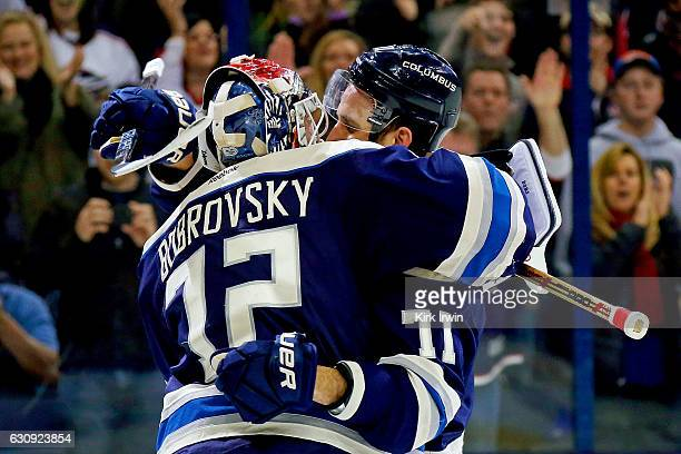 Nick Foligno of the Columbus Blue Jackets congratulates Sergei Bobrovsky after defeating the Edmonton Oilers 31 for the teams 16th consecutive...